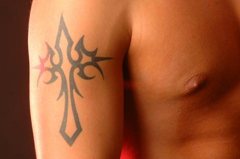 christian cross tattoo of made nails tattoo. Black Bedroom Furniture Sets. Home Design Ideas